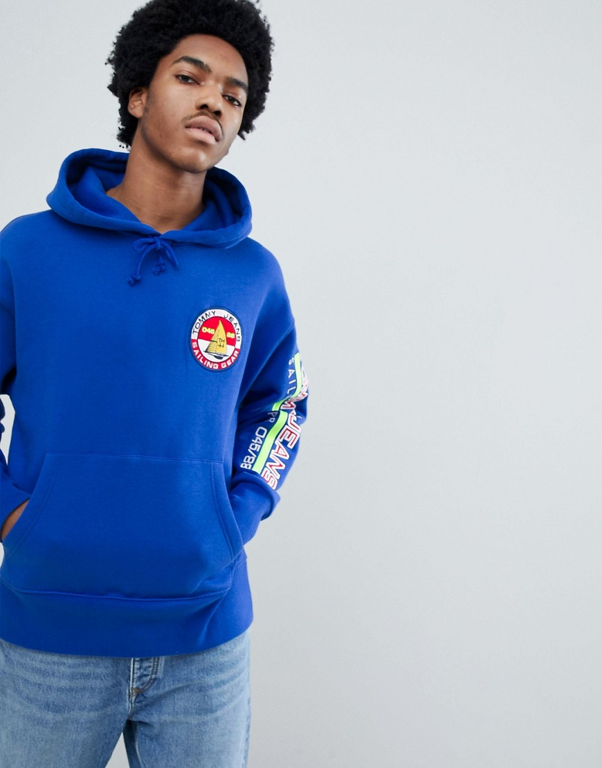 Tommy Jeans 90s Sailing Capsule Back and Sleeve Logo Hoodie in Bright Blue - Surf the web