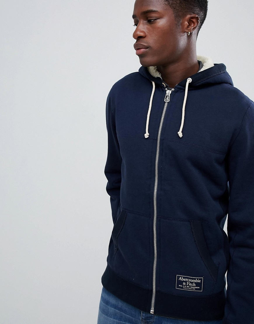 Abercrombie & Fitch borg lined full zip hoodie chest logo in navy - Navy